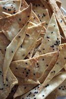 Olive oil crackers with Hawaiian sea salt and black sesame seeds.