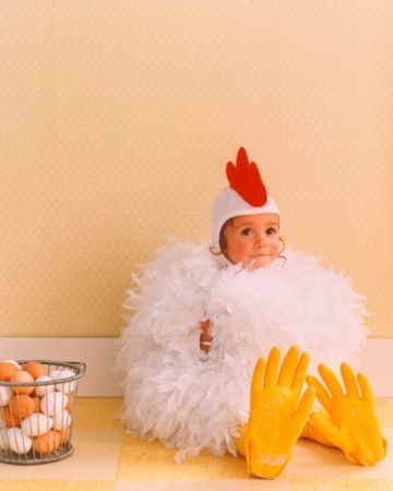 SO EASY! Spring Chicken costume is made from two tickley feather boas, ordinary kitchen gloves, yellow tights, and a pilots cap thats crowned with a felt comb. Under the plumage, two leotards are stuffed with batting for extra plumpness