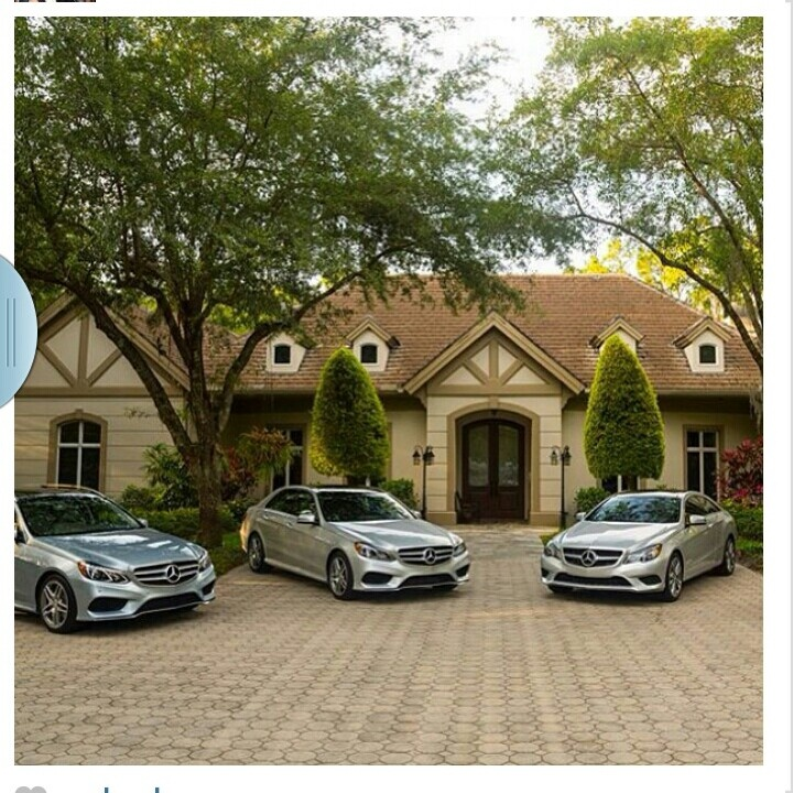 Nice house with 3 cars in the driveway