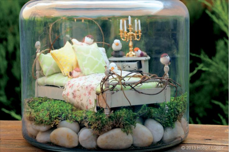 This miniature bedroom (created with dollhouse supplies) is a whimsical DIY Fairy bedroom!