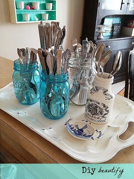 Organization in a small kitchen   Diy beautify Use pretty jars to store utensils; when corralled on a decorative tray, it's storage and decor in one! See more at http://diybeautify.blogspot.com/2014/01/organizationinasmallkitchen.html#axzz2qDeJifQL