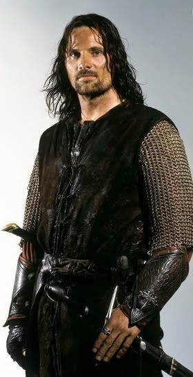 I kind of picture Gwydion to look like this... but with green eyes and gray in his hair, of course.