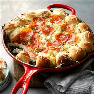 Cheesy Skillet Pizza Dip Recipe -This creamy dip is oozing with cheesy goodness thanks to the combination of cream cheese and mozzarella. We topped ours with pepperoni slices, but you can easily customize it with your favorite pizza toppings. This is just one more delicious way to use your cast iron pan. —Taste of Home Test Kitchen, Milwaukee, Wisconsin