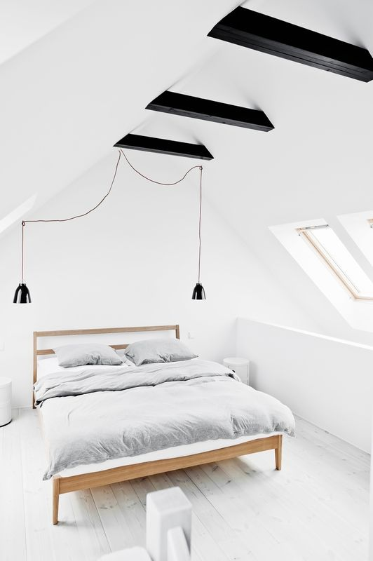 A fantastic looking loft bedroom, don't you think? I'd use white frame roof windows instead of pine to complement the décor. They'd be top hung too so I can stand at my window and enjoy the view with plenty of head space.