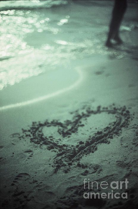 Love heart drawn on beach sand at low tide with ocean sea fine art prints.