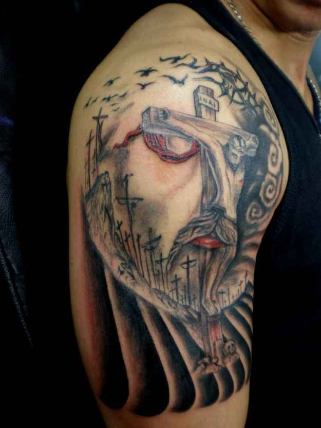 Face of Jesus, or Jesus on the cross?   18 Optical Illusion Tattoos That Will Make You Take A Second Look