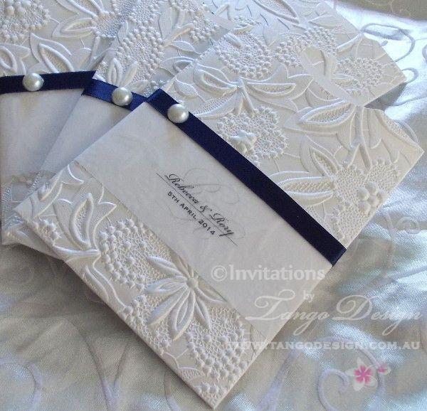 Embossed pocket sleeve invitation for elegant weddings by www.tangodesign.com.au #navyblueinvitations #handmadeinvitations #embossedinvitations