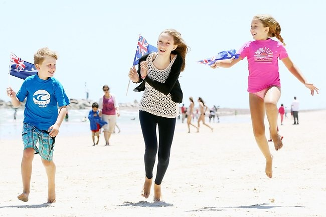 Daniel, 9, with his friend Melissa, 9, and her older sister Lauren, 13, celebrating Australia Day with the family on the beach at Glenelg in South Australia.
