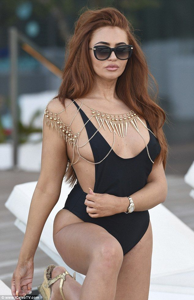Charlotte Dawson set temperatures soaring in a barely-there swimsuit as she lounged around the pool at the W Hotel in Barcelona.
