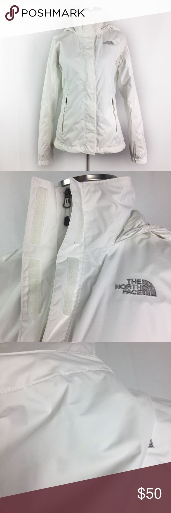 """The North Face White Hooded Rain Jacket Zip Up •The North Face White Hooded Rain Jacket •Women's Size XS •In good preowned condition with light yellow spot on hood and a few tiny unnoticeable spots throughout •Nylon/ Polyester •All measurements are approximate: 25"""" length, 19"""" across chest, 21.5"""" sleeve length The North Face Jackets & Coats"""