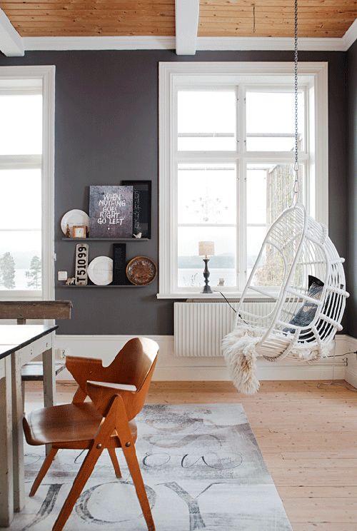 charcoal walls, white trim, medium wood tones