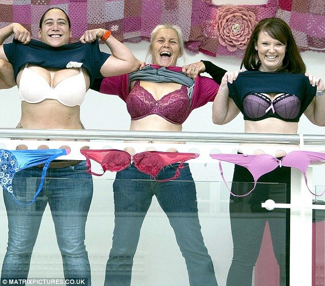 Erika (centre), bared her breasts again with the Swindon Supermarine Ladies Rugby Club to launch the campaign Bra The Brunel in October 2015 - to raise awareness and funds for research into breast cancer