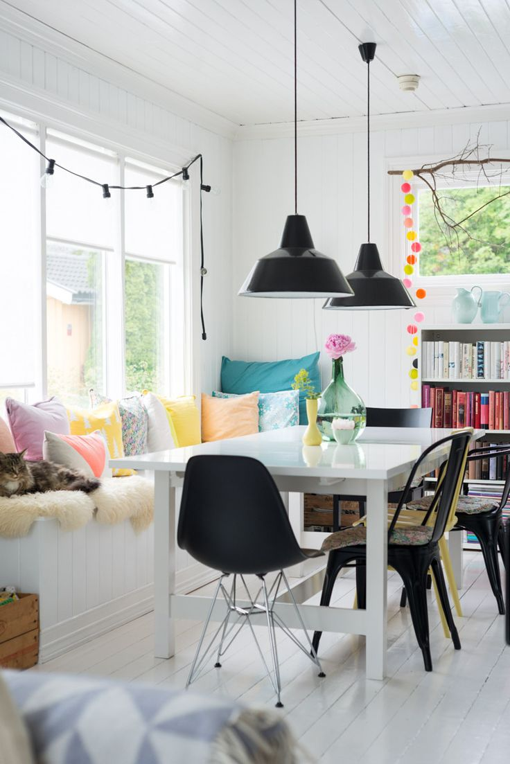 Mixed style of chairs, multicolored, rustic lamps, casual lighting, built in bookcase, THIS is a dream