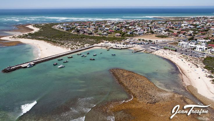 Fishing boats at rest in the picturesque harbour at Struisbaai | ©Jean Tresfon #Struisbaai #fishingboats #harbour