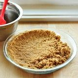 Pour the crumbs into a 9-inch pie pan and press them evenly along the bottoms and sides.
