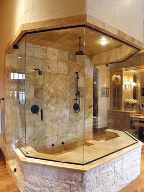 steam shower and custom tile separate the his bath from the her bath