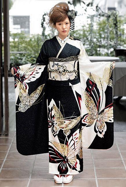 Modeling a contemporary furisode. Japan. Image via Pinterest