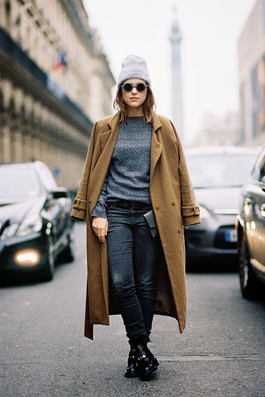 Shop this look for $267:  http://lookastic.com/women/looks/beanie-and-cable-sweater-and-overcoat-and-clutch-and-jeans-and-boots/918  — Grey Beanie  — Charcoal Cable Sweater  — Tobacco Coat  — Grey Leather Clutch  — Navy Jeans  — Black Leather Boots