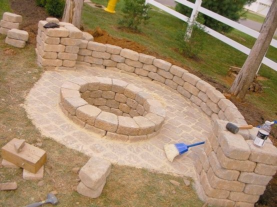 DIY fire pit. around $200 for pit and wall and pillars at $1.31/paver @ Home Improvement Ideas