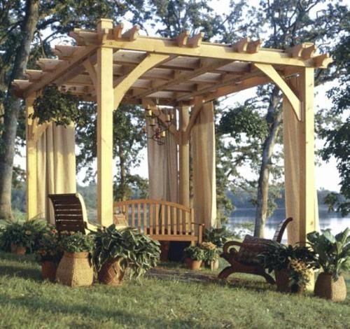 Wooden windows can be hung between supportive posts to make an outdoor room.