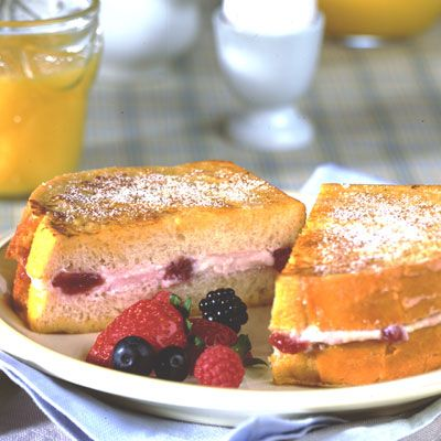 Stuffed French Toast With Fresh Berry Topping. Valentine's Day Breakfast in Bed