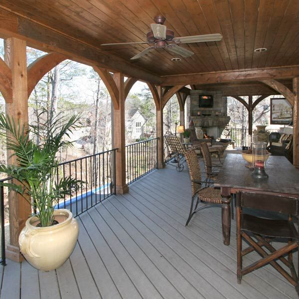 Handsome Hand Carved Arches Grace The Exterior Frame Of This Beautiful Covered  Deck Porch. The