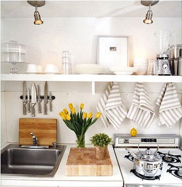 """Transform a tiny kitchenette into a functioning chef's space:  A magnetic wall strip contains the knives, and open shelves keep dinnerware close at hand."""