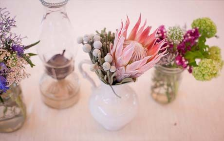 Like the contrast of shapes of the flowers used in the white vase.