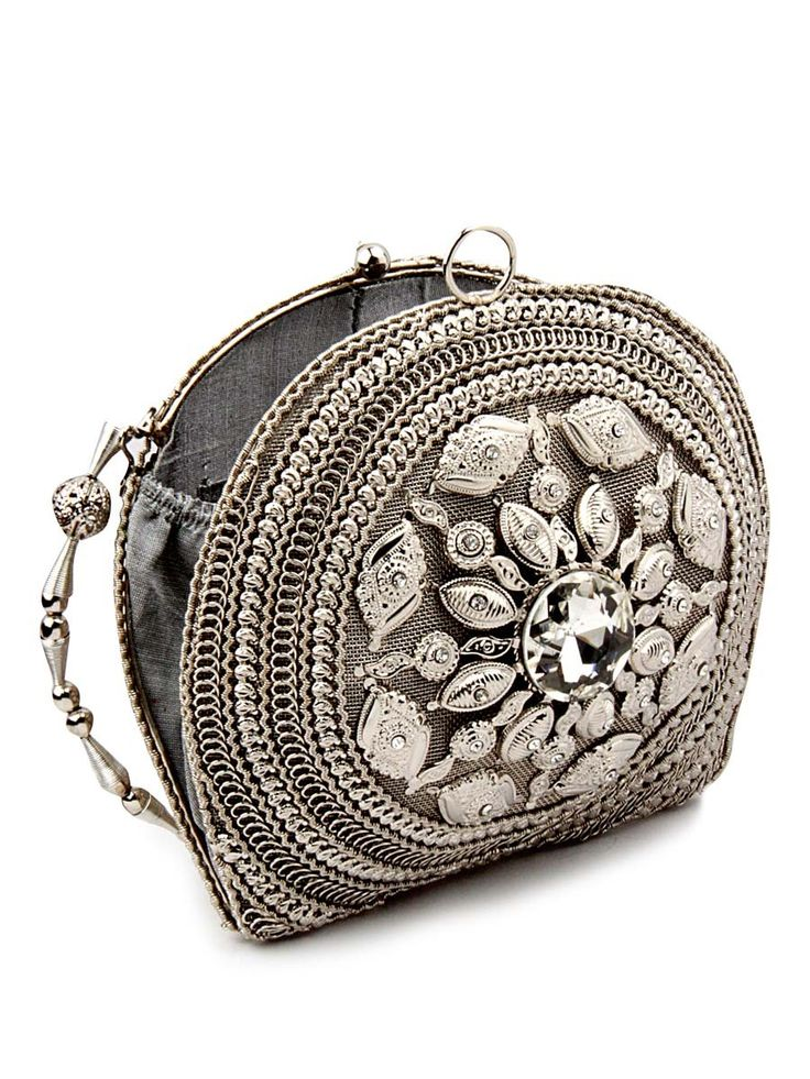 Charming silver color designer clutch made from brass metal beautified with crystal and diamantes. Item Code: SJBP2021 http://www.bharatplaza.com/new-arrivals/accessories.html