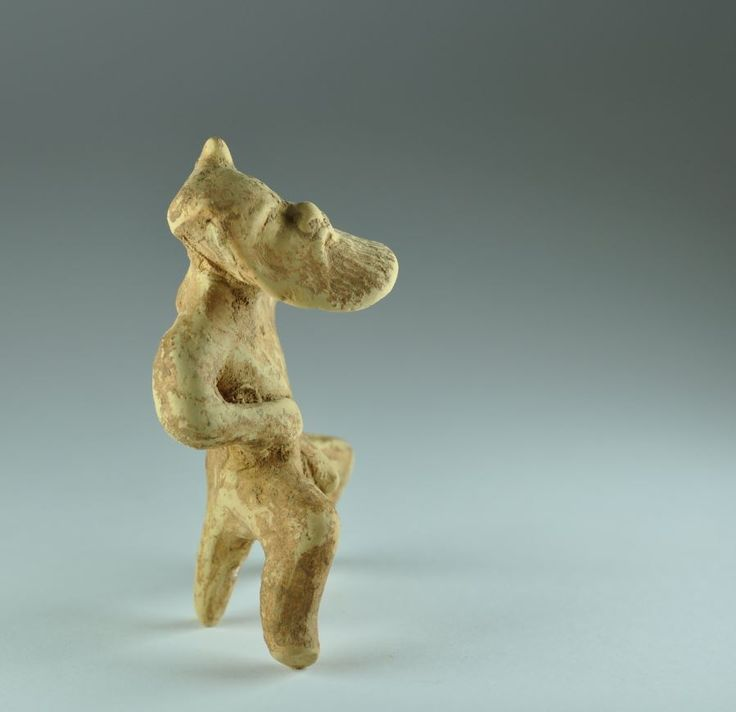 Corinthian archaic pottery statuette satyr, Greek, Corinth, mid 5th century B.C. Greek Corinthian bearded sitting satyr supported by his tail, 7.8 cm high. Private collection