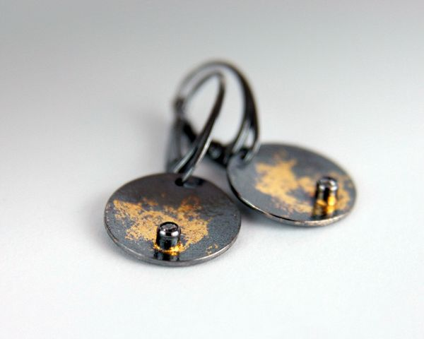 Earrings: sterling silver, 22-karat gold, hand fabricated, oxidized,keum boo.