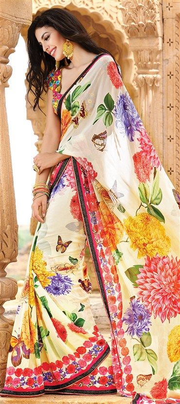 122959: Multicolor color family Saree with matching unstitched blouse.