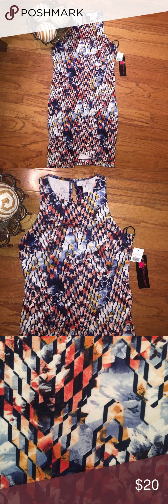 NWT Bodycon Dress This is a printed Bodycon dress. Pulls overhead with one button in back at neck. Asymmetric, flattering with lots of give, however if your larger than a medium it will not fall right. Colors include Ivy, blue, coral according to tag. 95% polyester 5% spandex. 32 1/2 inches at shortest part and 34 1/2 inches at the longest part of the skirt. Pair with Jean blazer and some boots you ready for fall... Dresses Asymmetrical
