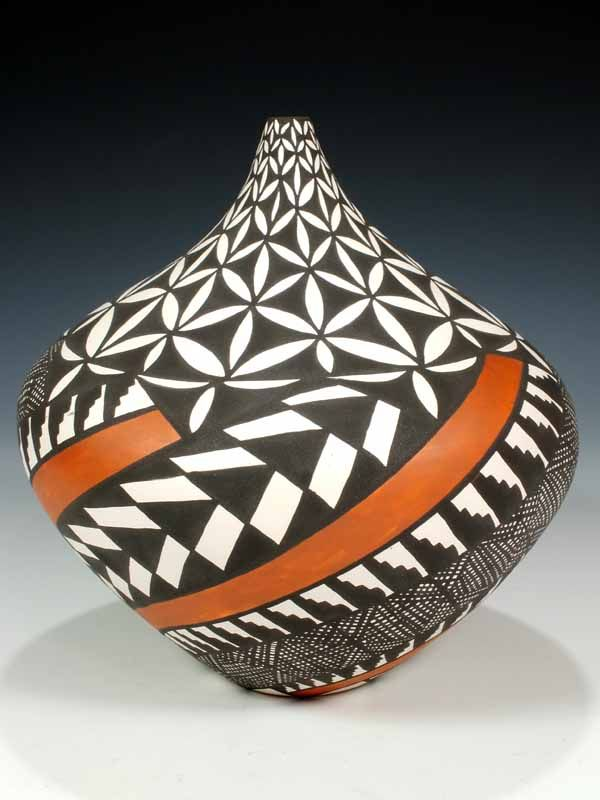Sandra Victorino is a full blooded Native American Indian born into the Pueblo of Acoma in 1958. She was inspired to learn the art of hand coiling pottery from admiring her famous Aunt, Dorothy Torivio, who was one of Acoma's finest potters.