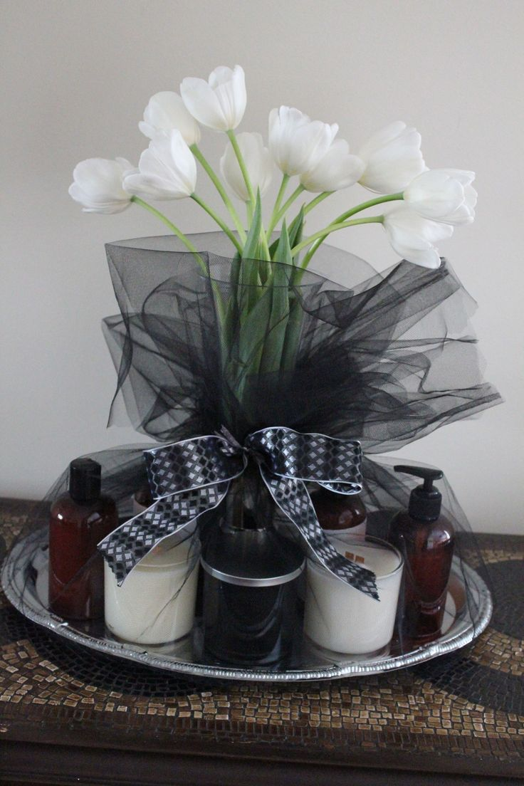 Luxurious gift basket created by Hollywood Baskets with fresh cut tulips, candles and spa product on a silver tray.  www.hollywoodbaskets.com