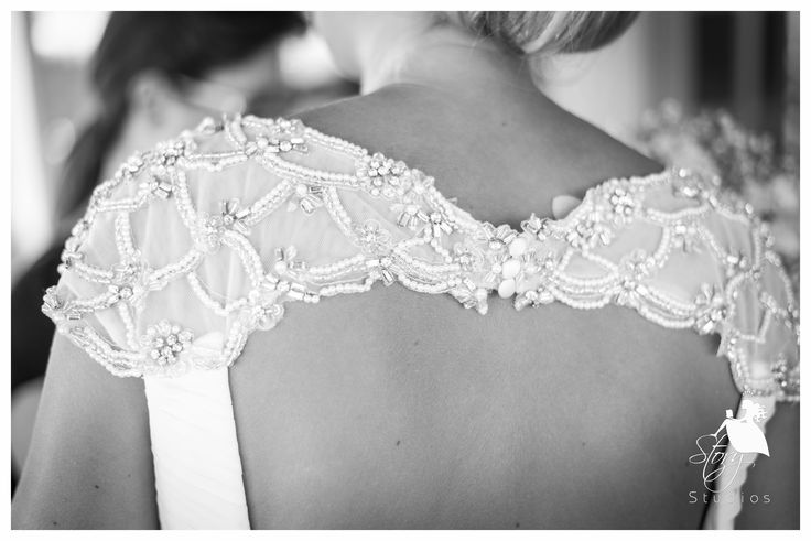 Beautiful backless wedding dress with lovely hand sewn beads!
