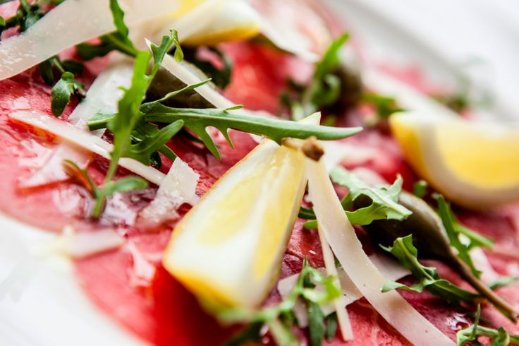 Angus Beef Carpaccio: Thinly sliced Beef Filet, Caper Berries, Parmesan Cheese, Rocket Salad, Lemon & E.V Olive Oil sprinkled with Truffle Salt Crystals