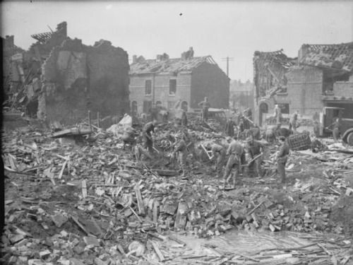 British troops clearing up bomb damage in Birkenhead, Cheshire suffered during The Blitz/15 March 1941