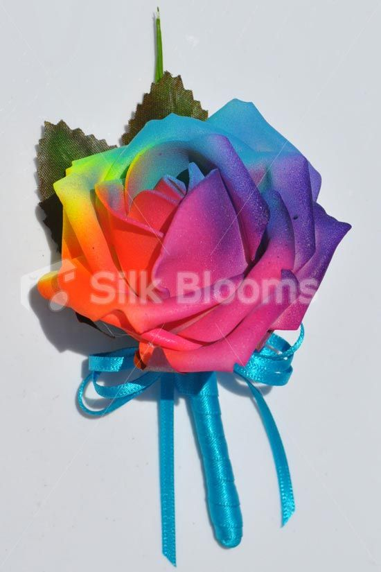 vibrant artificial neon rainbow rose wedding buttonhole w