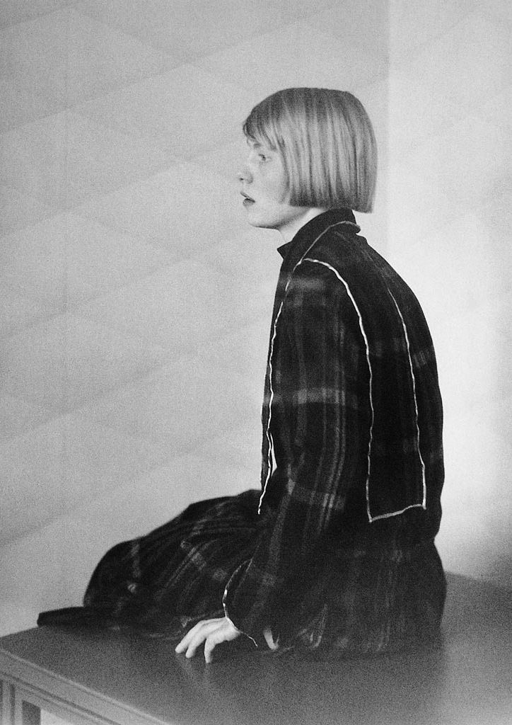 Check dress   Sitting girl   Bobbed hair   Photograph by August Sander, 1920s   Black and white picture