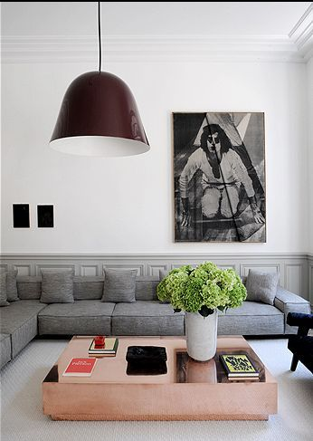 copper coffee table, grey sofa, huge pendant lamp. Decor. Living Room. Portrait. Art. Home. Design.