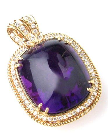 An amethyst, diamond and 18k gold pendant enhancer centering one cushion cut cabochon amethyst measuring 22.5 x 19 x 14.8mm surrounded by numerous round brilliant cut diamonds weighing an estimated total of approximately 0.65ct.