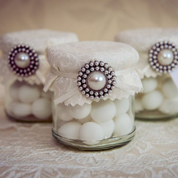 Ivory wedding favour jar. Pearl brooch decoration.