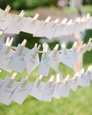 Escort cards were paired with personal messages and strung on clotheslines