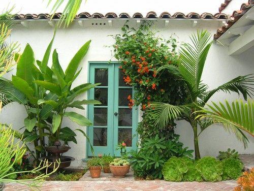 perfect tropical door color & plantings..prettyTurquoise Door, Tropical Landscapes, Doors Design, Landscape Design, Tropical Design, Front Doors, Tropical Gardens, Landscapes Design, Doors Colors