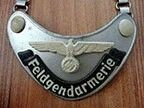 """the """"Ringkragen"""" as worn by Feldgendarmerie units in occupied territories controlled by the Wehrmacht. These Police units were employed within army divisions under the High Command of the Wehrmacht but often worked in close cooperation with the Geheime Feldpolizei (Secret Field Police), district commanders and SS and Police Leaders."""