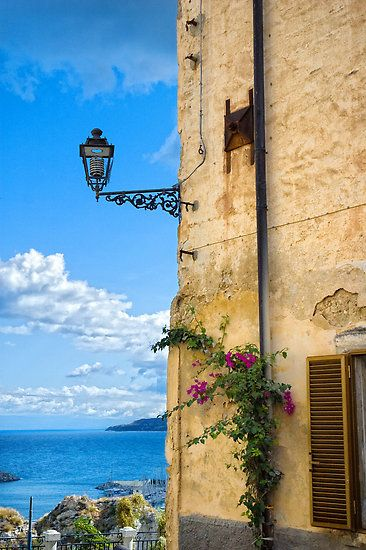 lamp on wall in Tropea, Calabria I was in Calabria, it's very beautiful place. :).
