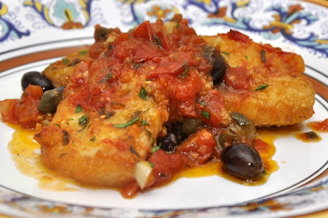 Baccalà alla napoletana, salted cod fish in Napoli style, a dish in a capital marine city