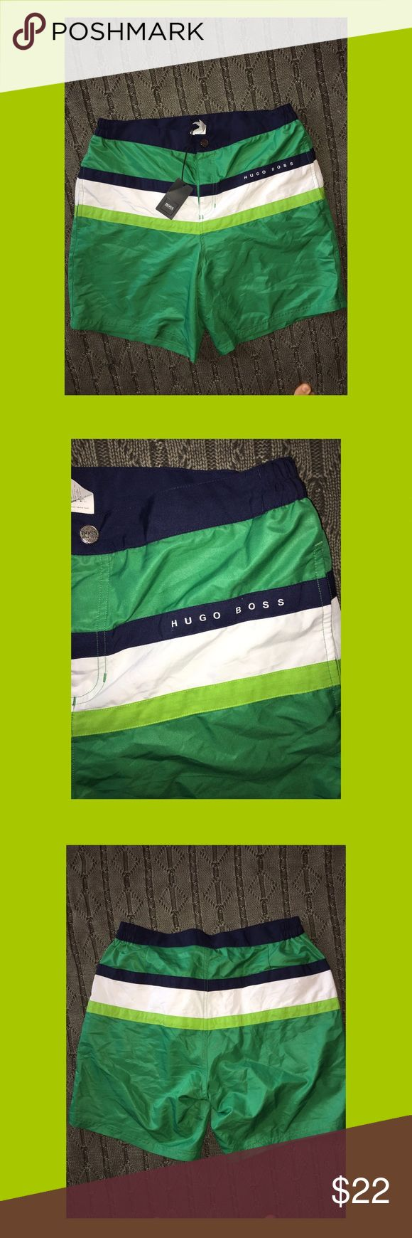 Men's Hugo Boss Green Swim Shorts NWT These are brand new with tags Hugo Boss swim shorts. They are emerald green with a lime green, white and navy stripe. There are two lines pockets and a front button closure with Velcro up the front. Hugo Boss Swim Swim Trunks