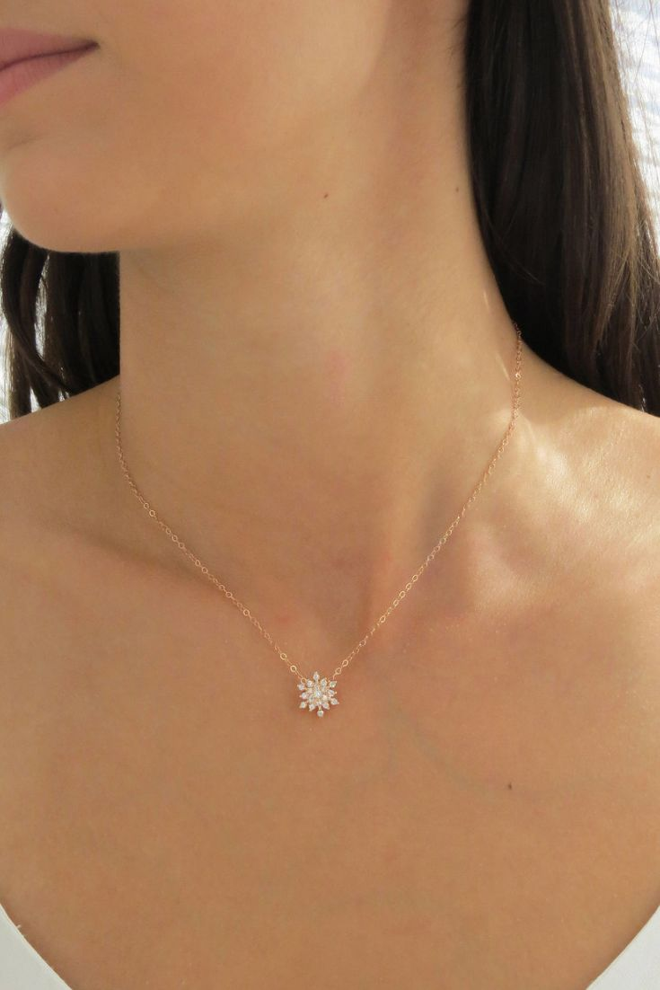 This 14k Rose Gold Filled Snowflake Necklace with Cubic Zirconias is super spark…